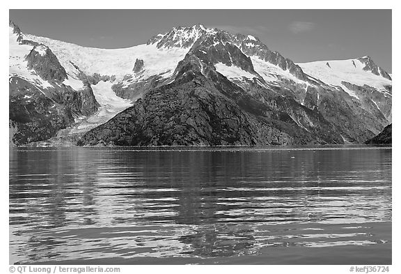 Rippled refections of peaks and glaciers, Northwestern Fjord. Kenai Fjords National Park (black and white)