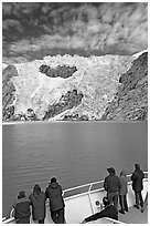 People watch  Northwestern glacier from deck of boat, Northwestern Lagoon. Kenai Fjords National Park ( black and white)