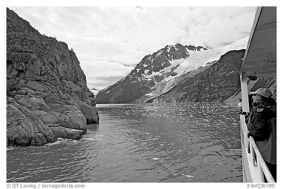 Passenger on small tour boat, island and glacier, Northwestern Fjord. Kenai Fjords National Park (black and white)
