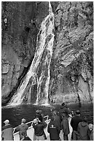 Passengers look at waterfall from tour boat, Cataract Cove, Northwestern Fjord. Kenai Fjords National Park ( black and white)