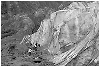 Family exploring at the base of Exit Glacier. Kenai Fjords National Park, Alaska, USA. (black and white)