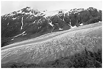 Exit glacier flowing down mountainside. Kenai Fjords National Park, Alaska, USA. (black and white)