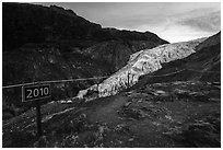 Sign indicating location of Exit Glacier in 2010. Kenai Fjords National Park ( black and white)