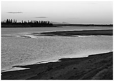 Sand bar shore, river, row of spruce trees,  and Baird mountains, evening. Kobuk Valley National Park ( black and white)