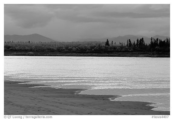 Sand bar shore, bright river and Baird mountains, evening. Kobuk Valley National Park, Alaska, USA.