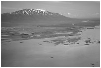 Aerial view of estuary and snowy peak. Lake Clark National Park, Alaska, USA. (black and white)