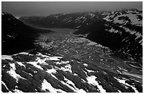 Aerial view of Tikakila River valley under dark clouds. Lake Clark National Park, Alaska, USA. (black and white)