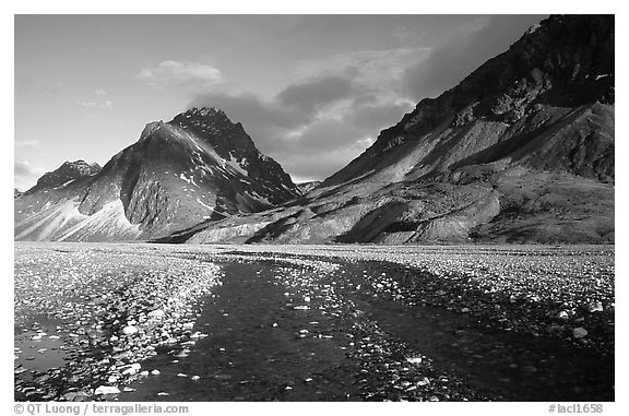 Wide gravel river bar below the Telaquana Mountains, sunset. Lake Clark National Park (black and white)