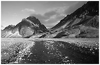 Wide gravel river bar below the Telaquana Mountains, sunset. Lake Clark National Park, Alaska, USA. (black and white)