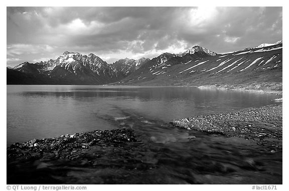 Stream flowing into Turquoise Lake, sunset. Lake Clark National Park (black and white)