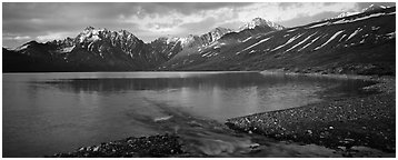 Stream flowing into mountain lake. Lake Clark National Park (Panoramic black and white)