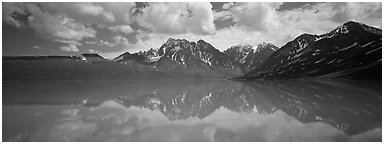 Clouds and mountains reflected in Turquoise Lake. Lake Clark National Park (Panoramic black and white)