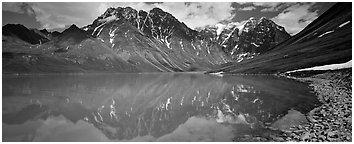 Tall mountains reflected in Turquoise Lake. Lake Clark National Park (Panoramic black and white)