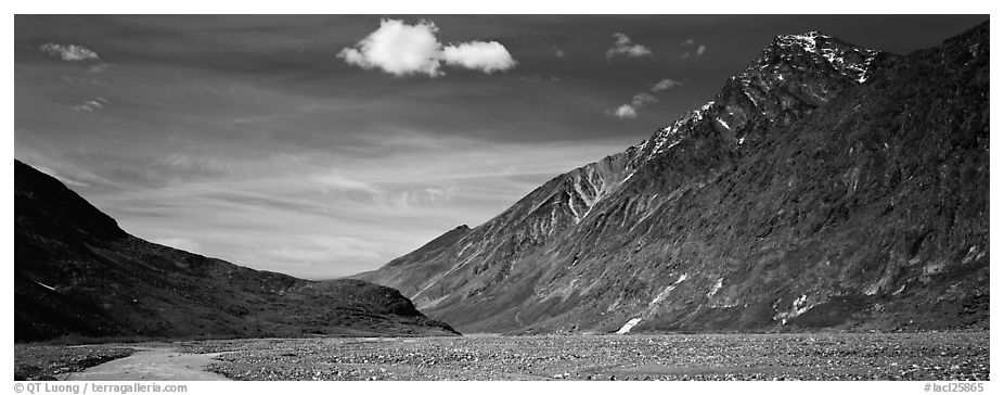 Peaks rising above gravel bar. Lake Clark National Park (black and white)