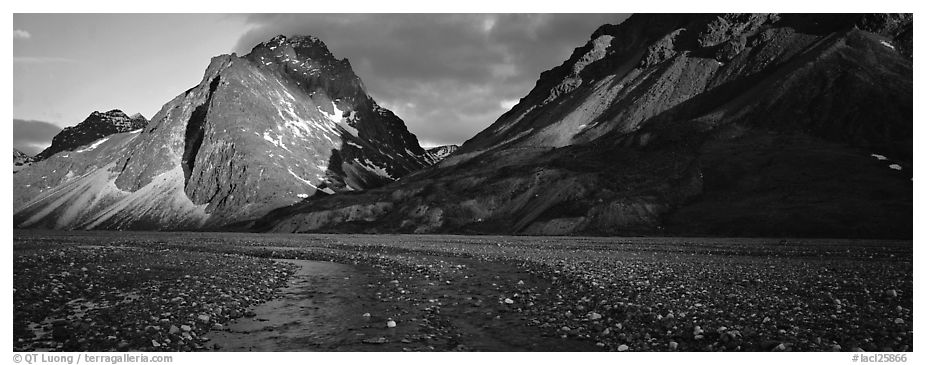 Stream, gravel bar, and mountains at sunset. Lake Clark National Park (black and white)