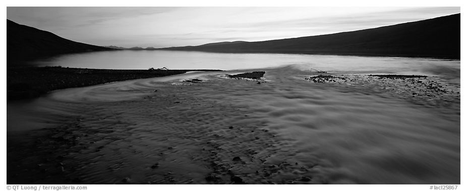 Wide stream flowing into lake at sunset. Lake Clark National Park (black and white)