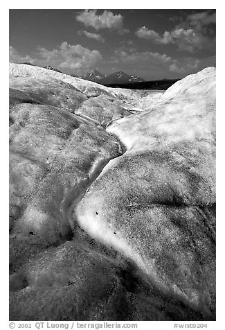 Ice, glacial creek on Root glacier, and mountains. Wrangell-St Elias National Park (black and white)