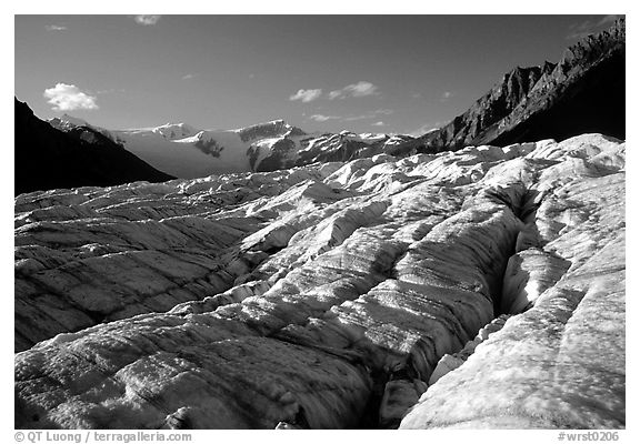 Crevasses on Root glacier, Wrangell mountains in the background, late afternoon. Wrangell-St Elias National Park (black and white)