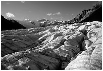 Crevasses on Root glacier, Wrangell mountains in the background, late afternoon. Wrangell-St Elias National Park, Alaska, USA. (black and white)