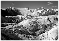 Crevasses on Root glacier, Wrangell mountains in the background. Wrangell-St Elias National Park ( black and white)