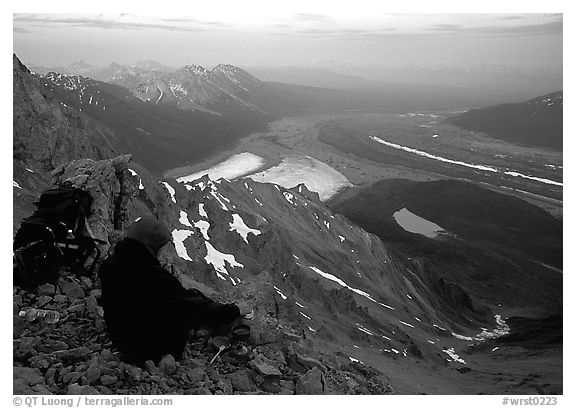 Mountaineer looking down from Mt Donoho. Wrangell-St Elias National Park (black and white)
