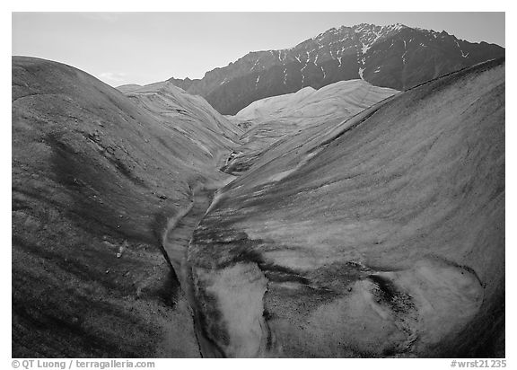 Root Glacier, glacial stream, and mountains at dusk. Wrangell-St Elias National Park (black and white)