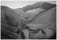 Root Glacier, glacial stream, and mountains at dusk. Wrangell-St Elias National Park ( black and white)
