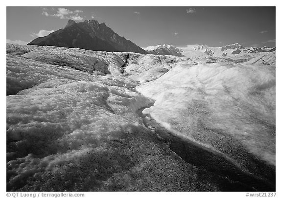 Stream running on surface of Root Glacier and Mt Donoho. Wrangell-St Elias National Park (black and white)