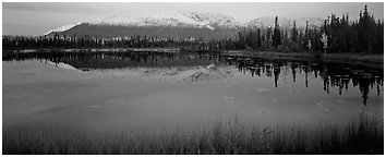 Pond and reflected mountains at dusk. Wrangell-St Elias National Park (Panoramic black and white)