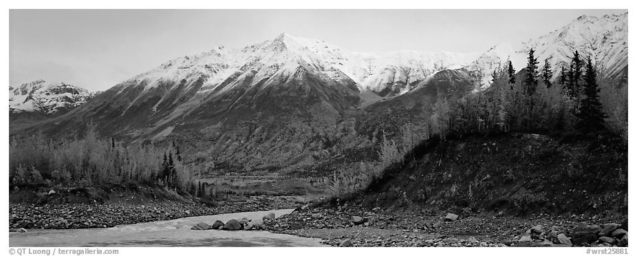 Autumn mountain landscape with snowy peaks above river and trees. Wrangell-St Elias National Park (black and white)