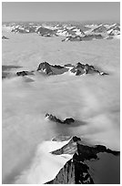 Aerial view of ridges and summits emerging from sea of clouds, St Elias range. Wrangell-St Elias National Park, Alaska, USA. (black and white)