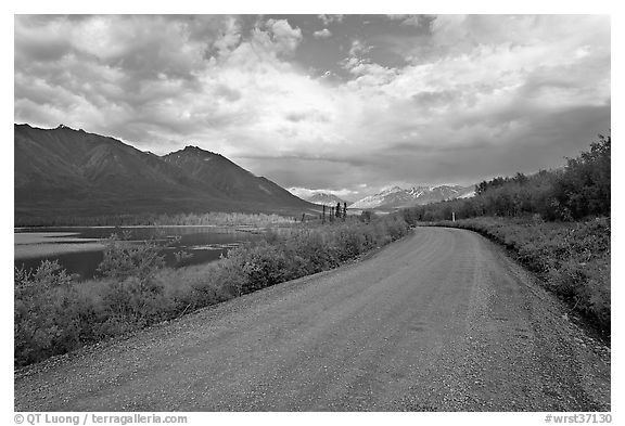 Unpaved McCarthy Road next to lake. Wrangell-St Elias National Park (black and white)