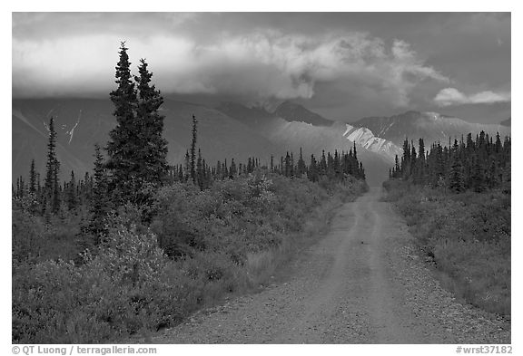 Nabena road at sunset with last light on mountains. Wrangell-St Elias National Park (black and white)