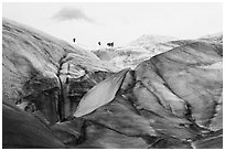 Distant hikers on Root Glacier from below. Wrangell-St Elias National Park ( black and white)