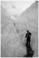 Hiker in narrow canyon, Root glacier. Wrangell-St Elias National Park ( black and white)