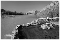 Tourist sitting in hot springs next to river. Big Bend National Park, Texas, USA. (black and white)