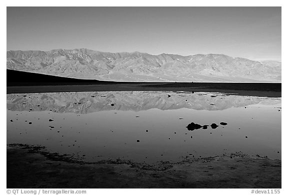 Panamint range reflection in Badwater pond, early morning. Death Valley National Park (black and white)
