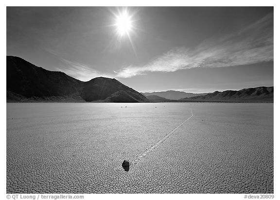 Moving rock on the Racetrack, mid-day. Death Valley National Park (black and white)