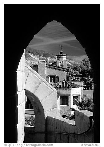 Arch framing Scotty's Castle. Death Valley National Park (black and white)