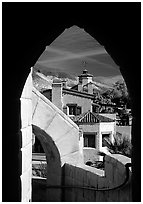 Arch framing Scotty's Castle. Death Valley National Park ( black and white)