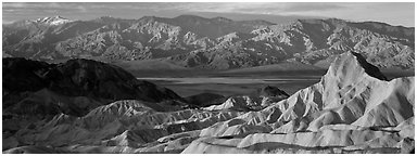 Zabriskie Point, Death Valley, and mountains in winter. Death Valley National Park (Panoramic black and white)