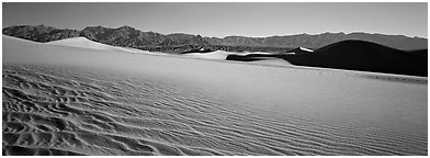 Landscape of sand dunes and mountains. Death Valley National Park (Panoramic black and white)
