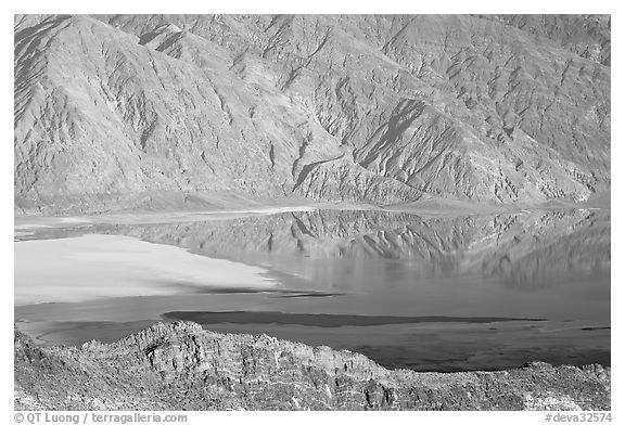 Rare seasonal lake on Death Valley floor and Black range, seen from above, late afternoon. Death Valley National Park (black and white)