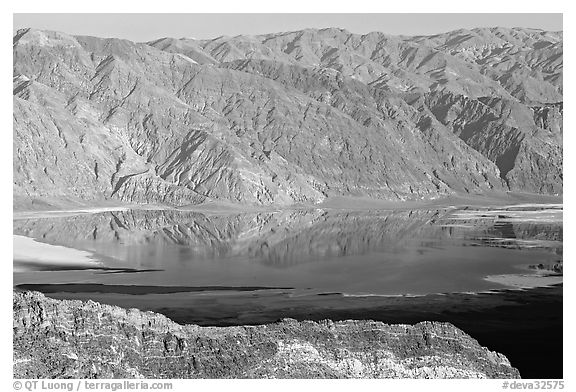 Flooded Death Valley floor at Badwater, seen from Aguereberry point, late afternoon. Death Valley National Park (black and white)