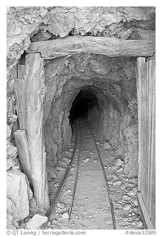 Entrance to a abandoned gallery of Cashier mine, morning. Death Valley National Park (black and white)