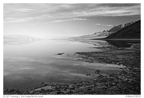 Flooded Badwater basin and Black mountain reflections, early morning. Death Valley National Park (black and white)