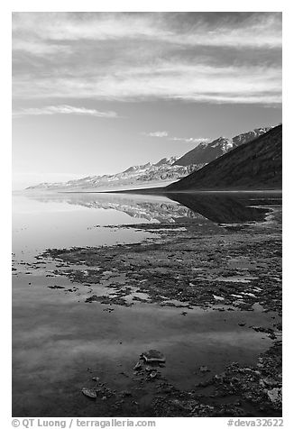 Black mountain reflections in flooded Badwater basin, early morning. Death Valley National Park (black and white)