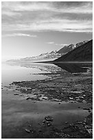 Black mountain reflections in flooded Badwater basin, early morning. Death Valley National Park ( black and white)