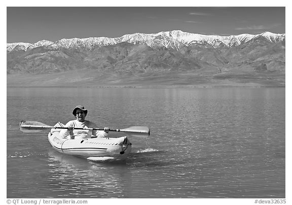 Kayaker padding ephemeral Manly Lake. Death Valley National Park (black and white)
