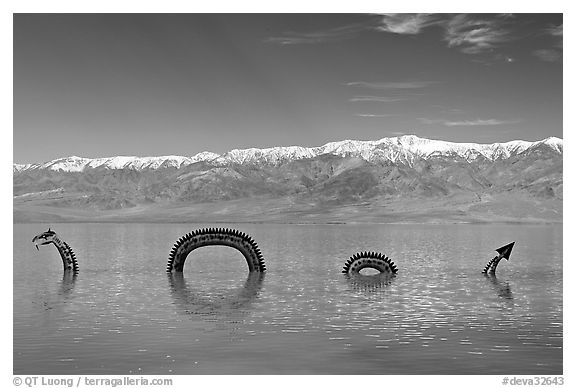 Dragon art installation in Manly Lake and Panamint range. Death Valley National Park (black and white)